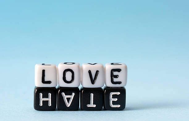 Some Boggle cubes spelling out the words love and hate stock photo