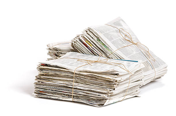Some bundles of newspapers on a white background Some bundles of newspapers on a white background bundle stock pictures, royalty-free photos & images