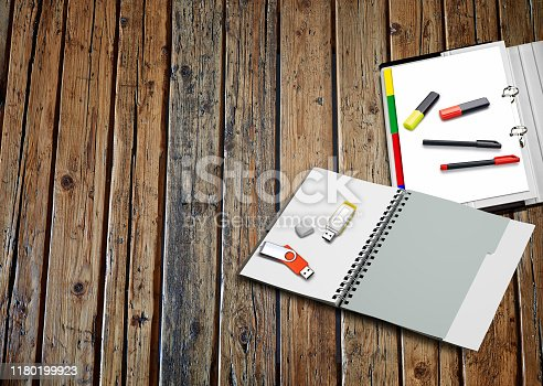 Some business objects on textured wooden table with space around