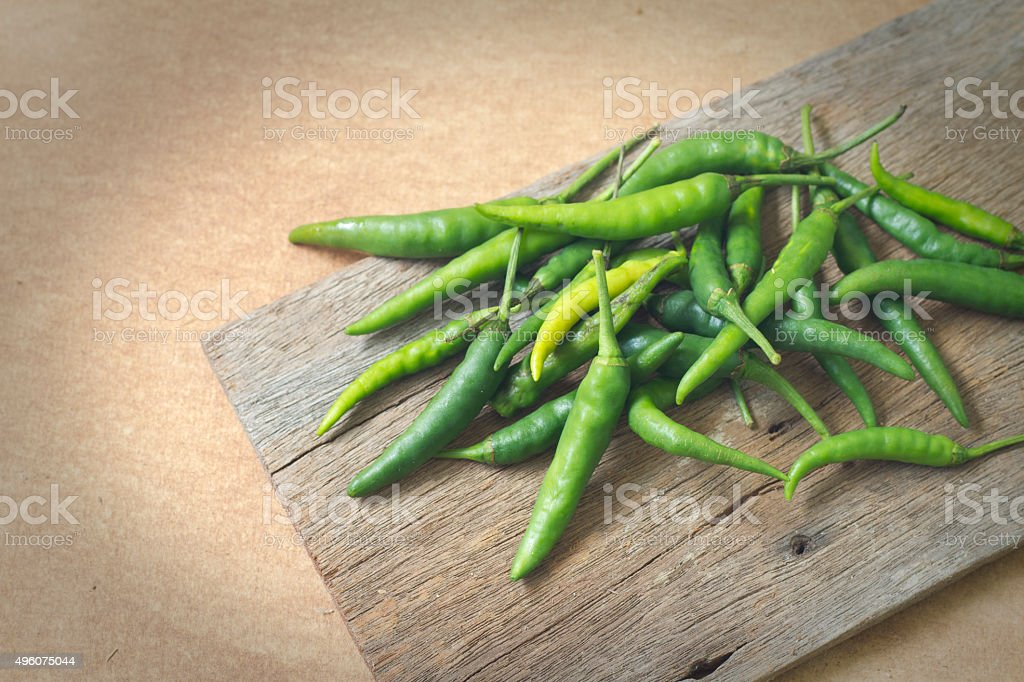 some chili peppers on the old wood stock photo