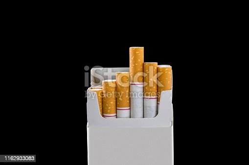 Some cigarettes are arranged neatly in a white wrap with black background