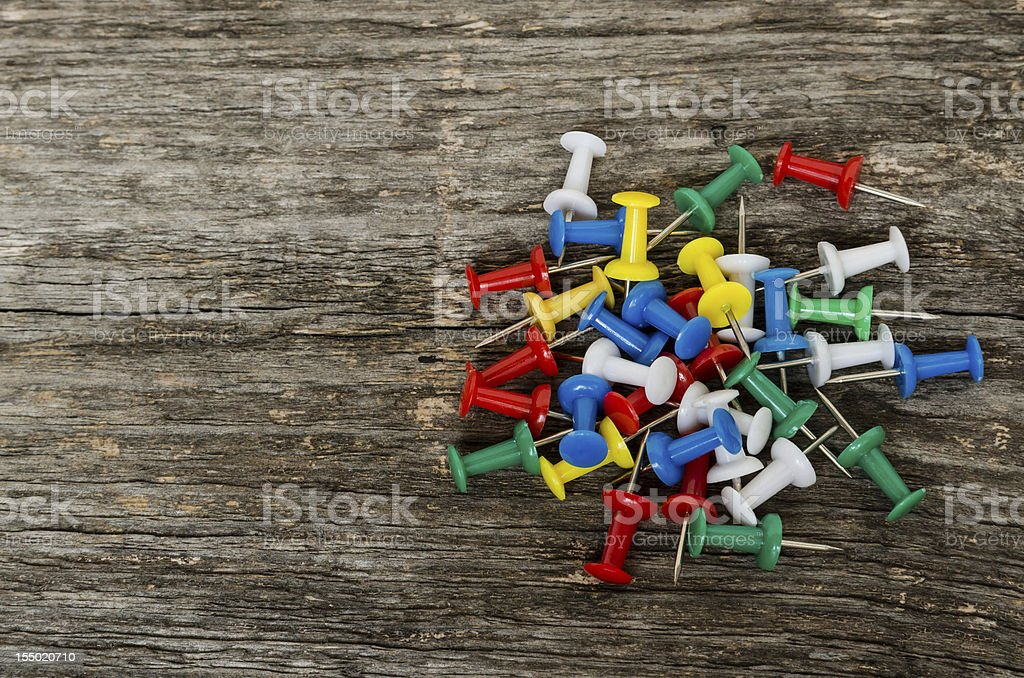 Some colored pushpins stock photo