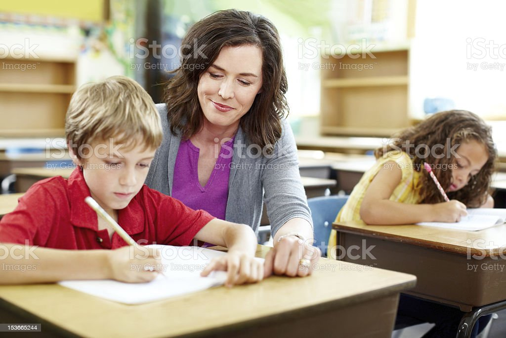 Some extra tutoring helps stock photo
