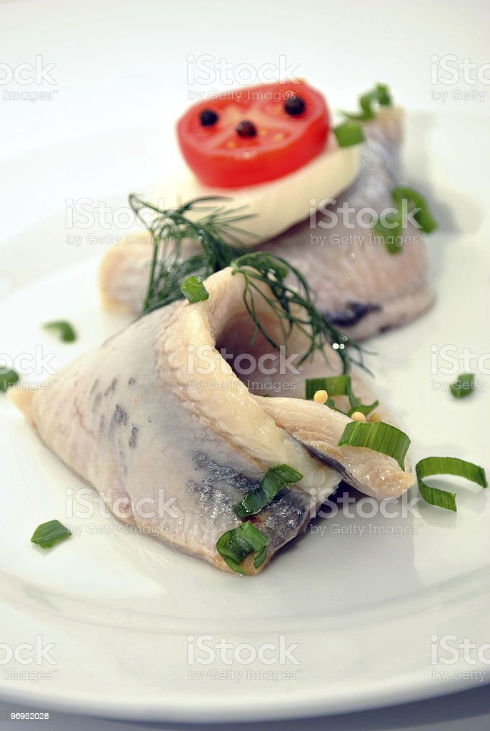 some fresh organic herring on a white plate royalty-free stock photo