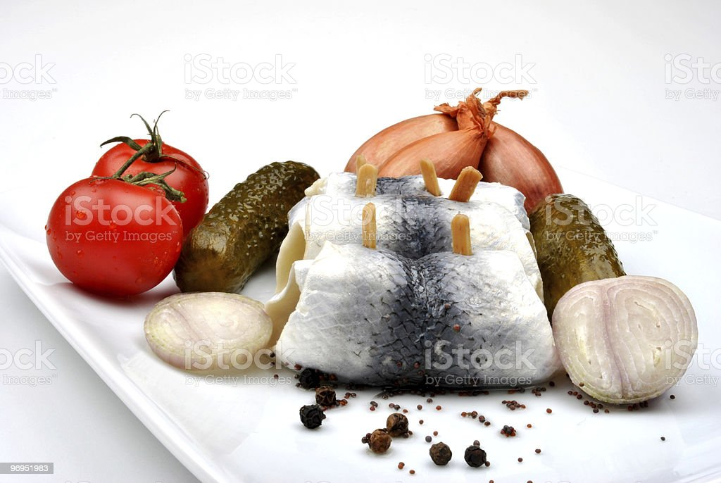 some fresh organic rollmops on a white plate royalty-free stock photo