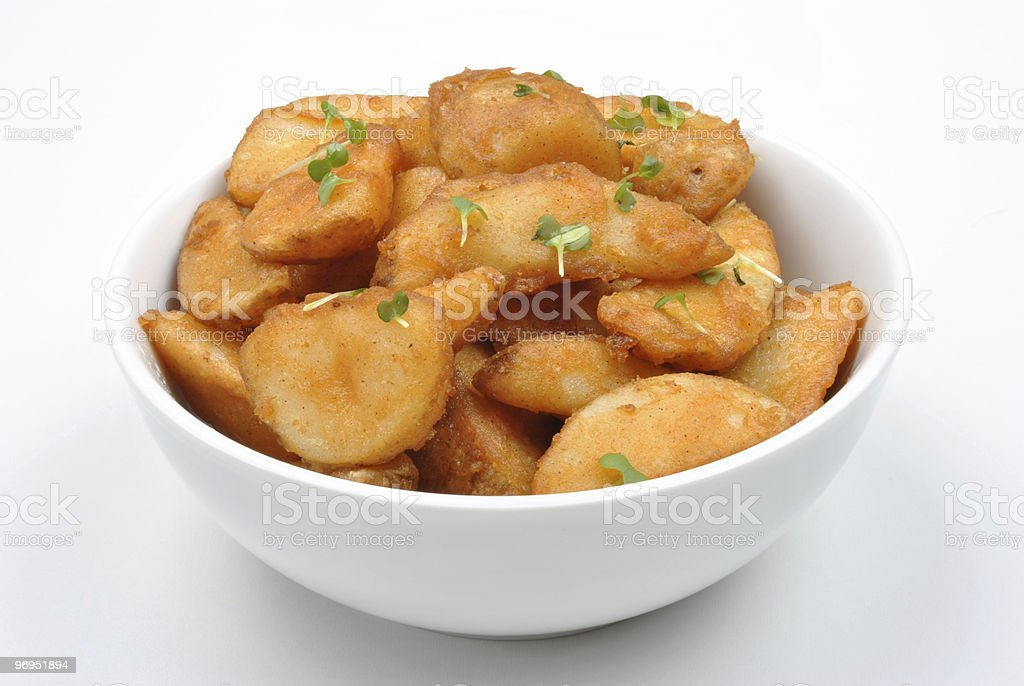 some fried potato wedges in a bowl royalty-free stock photo
