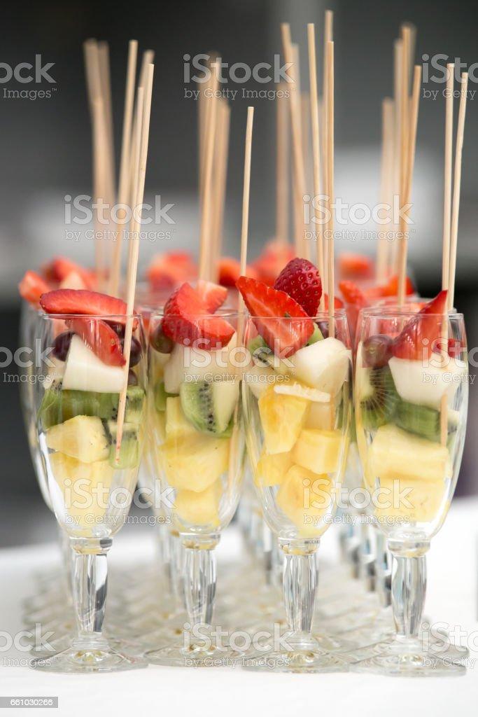 Some glasses full of fruit stock photo