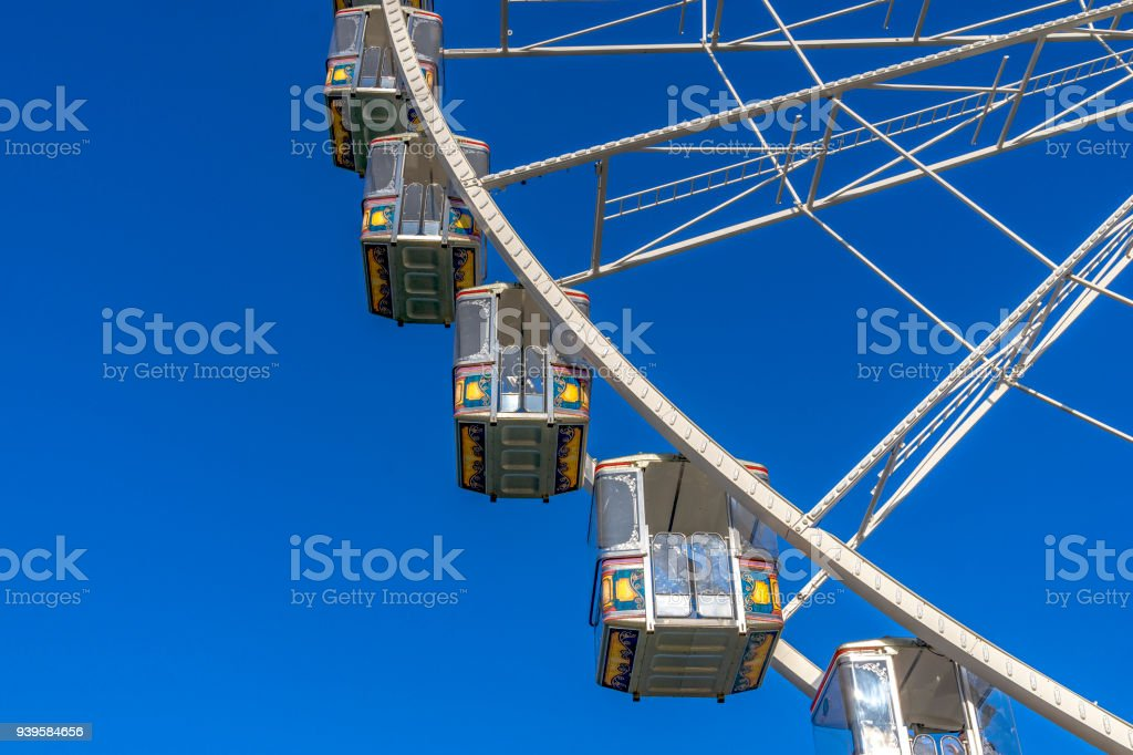 Some gondolas at a Ferris wheel at the spring fair in Mainz, Rhineland Palatinate, Germany stock photo