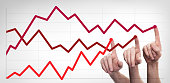 istock Some Hands drawing line chart and business strategy. Success competition concept 1155278846