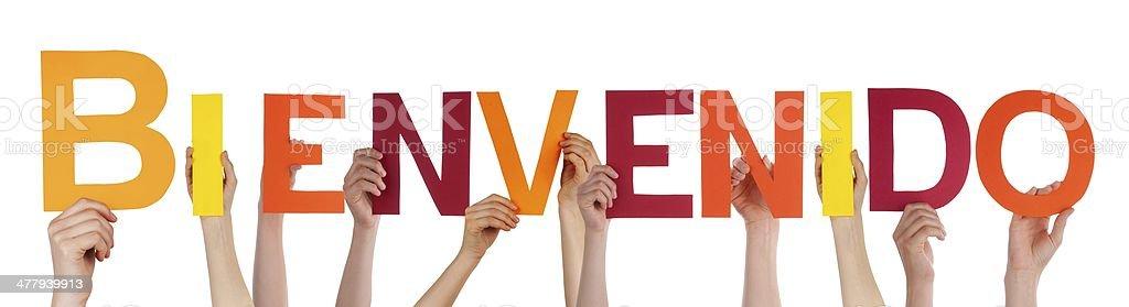 Some Hands Holding Bienvenido stock photo