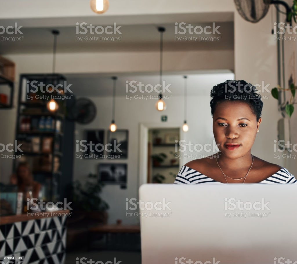 Some like the office, she prefers the cafe stock photo