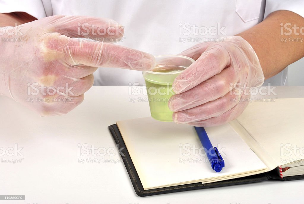some liquid in a measuring cup stock photo