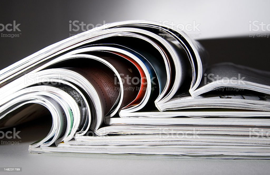 Some magazines with dramatic light stock photo