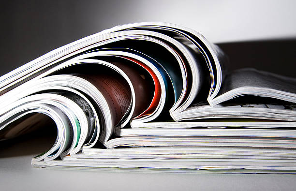 Some magazines with dramatic light Some magazines with dramatic light article stock pictures, royalty-free photos & images
