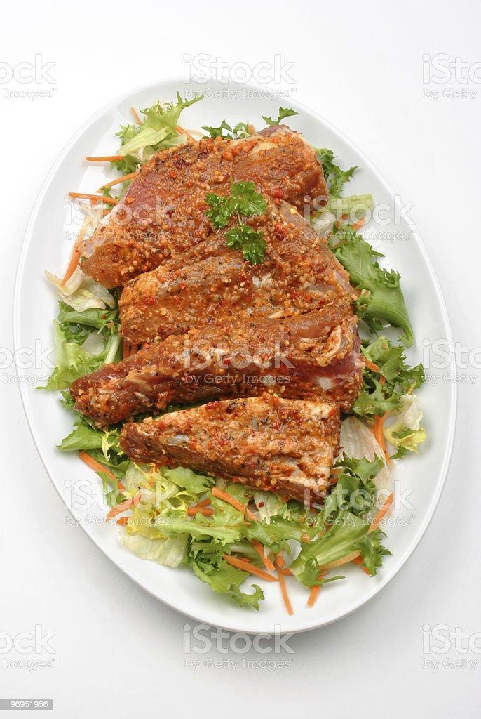 some marinated organic rib on healthy salad royalty-free stock photo