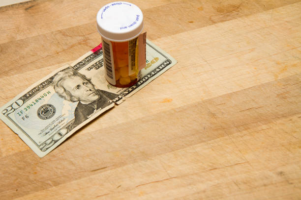some meds and money - prescription meds stock pictures, royalty-free photos & images