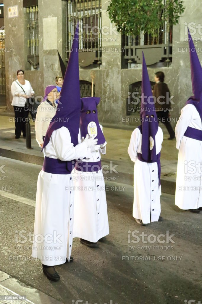 Some Members Of A Catholic Brotherhood Wearing The