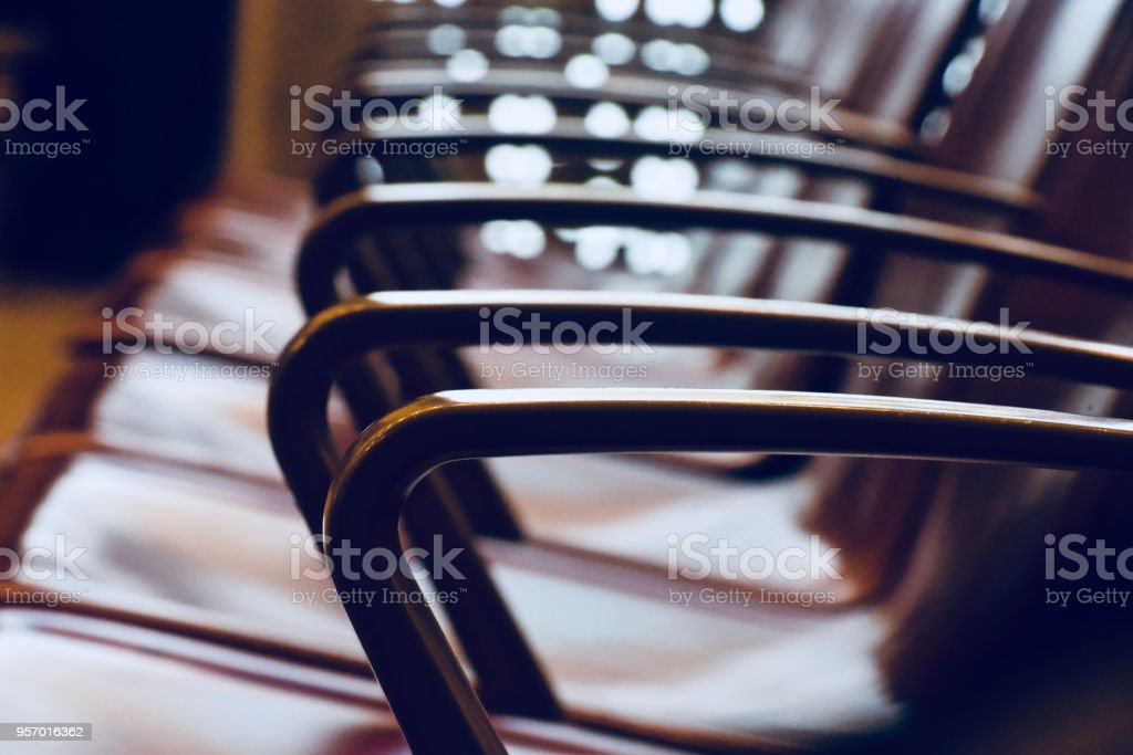 Some metallic chairs in a row isolated photograph stock photo