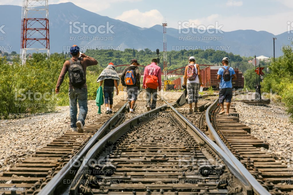 USA/Mexico Border - Migrants Coahuila, Mexico, Jun 16 - A group of migrants of Central American origin waits on the railway line to get on a container train, known as 'The Beast', to go to the border of the United States and Mexico, between the states of Coahuila (Mexico) and Texas (USA). Adults Only Stock Photo