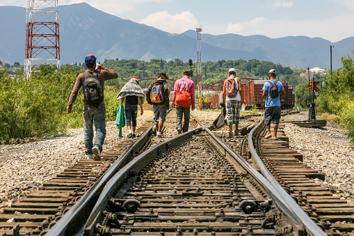 Coahuila, Mexico, Jun 16 - A group of migrants of Central American origin waits on the railway line to get on a container train, known as 'The Beast', to go to the border of the United States and Mexico, between the states of Coahuila (Mexico) and Texas (USA).