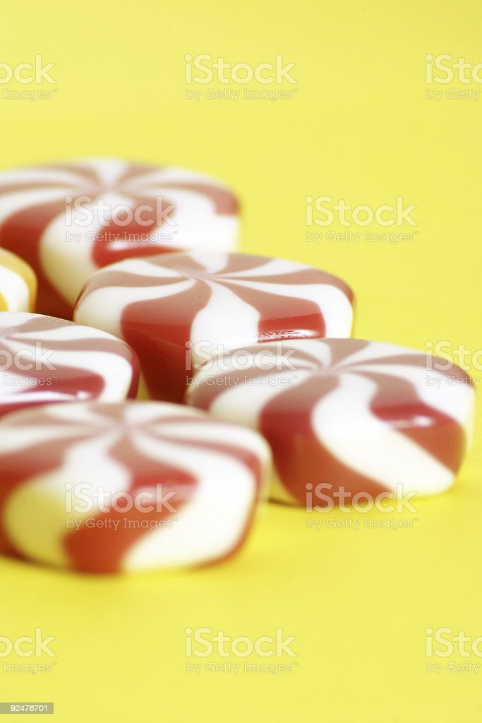 some more candy on a yellow background royalty-free stock photo