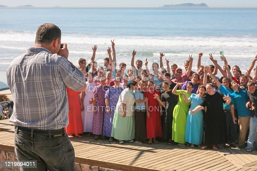 Playas de Tijuana, Mexico, February 14 - A group of young Mormons posing for a photo in the promenade in Tijuana Beach (Playas de Tijuana) near the border wall between Mexico and United States, on the Pacific Mexican Coast, in the Baja California State.