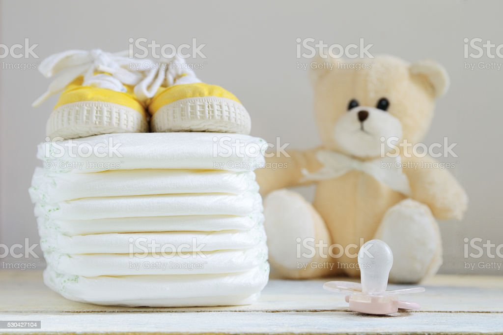 Some nappies on a white wooden table. stock photo