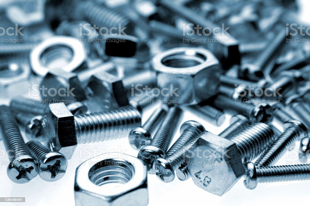 Some new silver nuts and bolts stock photo