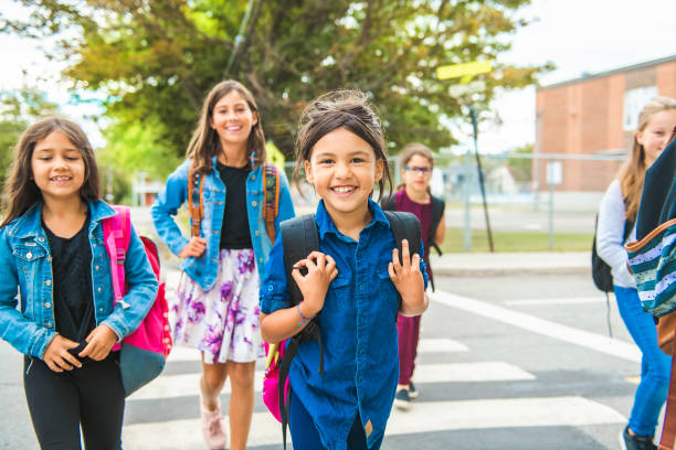 Some nice kids on the school background having fun stock photo