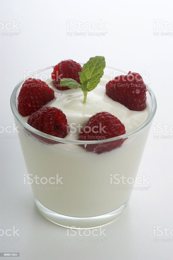some organic raspberries in natural yogurt and mint royalty-free stock photo