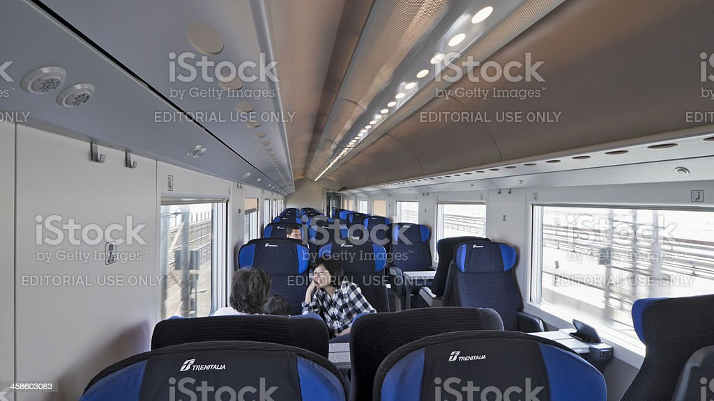 Some passengers seated on a Frecciabianca train royalty-free stock photo