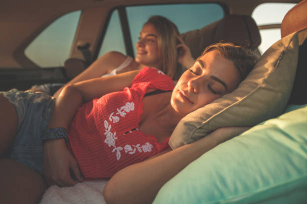 Some people sleeps during trips full of adventure stock photo