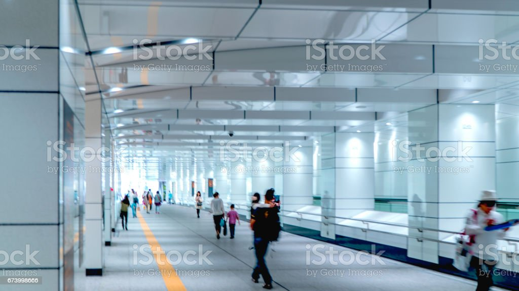 Some people walking on a walkway in Tokyo royalty-free stock photo