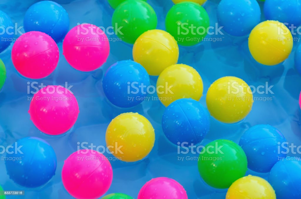 Some plastic balls in a pool stock photo