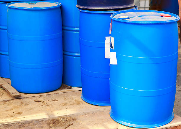 Some plastic blue barrels stock photo