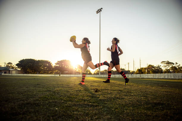 Some play football with their feet, some with their heart stock photo