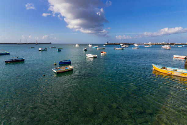 Some separated color boats in a little harbor of Arrecife, Lanzarote stock photo