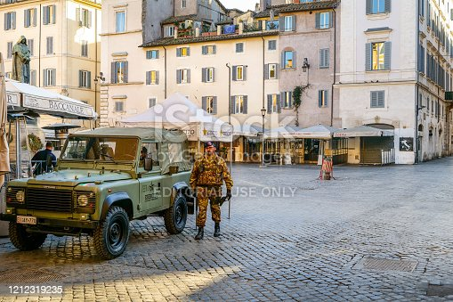 Rome, Italy, March 11 -- Elements of the Italian army guard Piazza Campo de Fiori which appears almost completely deserted and with all the restaurants and shops closed due to the emergency.