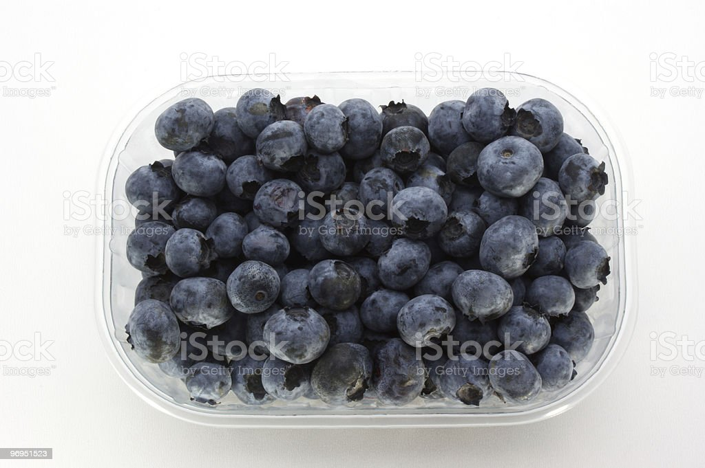 some sweet organic blueberries in a plastic container royalty-free stock photo