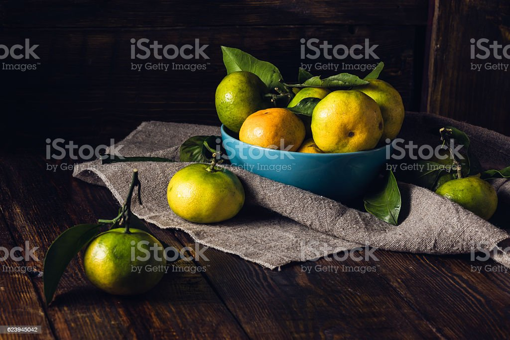 Some Tangerines in Blue Bowl stock photo