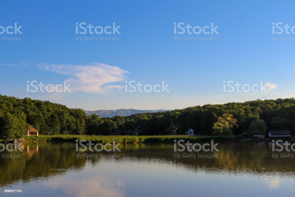 Some wooden millls in the reflections stock photo