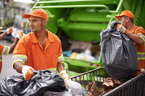 Somebody's got to do it Cropped shot of a garbage collection team at work street sweeper stock pictures, royalty-free photos & images