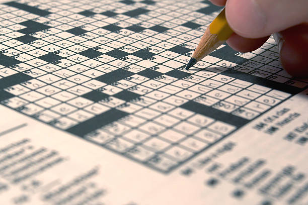 Someone doing the daily crossword stock photo
