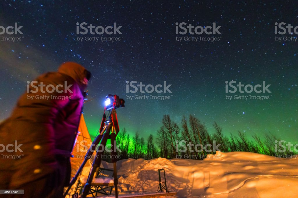 Someone filming the Northern Lights in Sweden stock photo