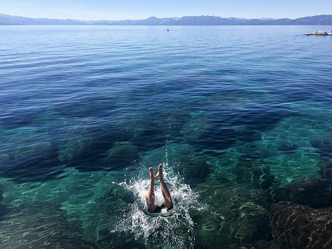 A man jumps into Lake Tahoe