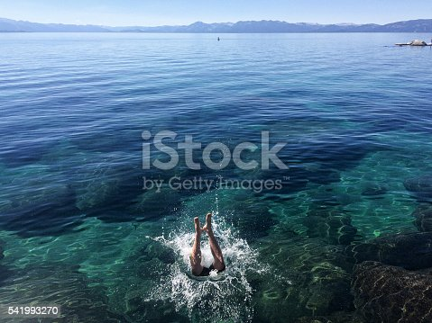 A man jumps into Lake Tahoe