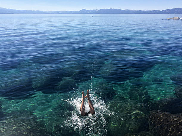 Someone jumping into Lake Tahoe stock photo