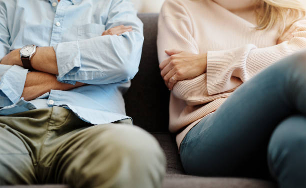 Someone messed up Cropped shot of a couple having a disagreement at home husband stock pictures, royalty-free photos & images