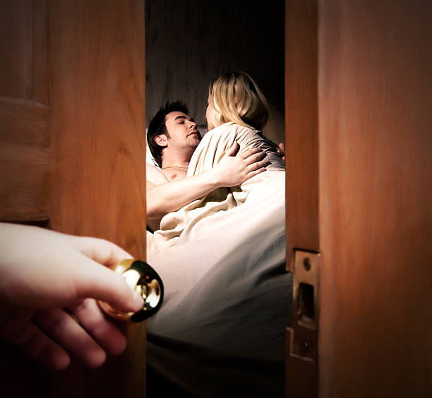 Someone opening a door and spying on man and young girl stock photo