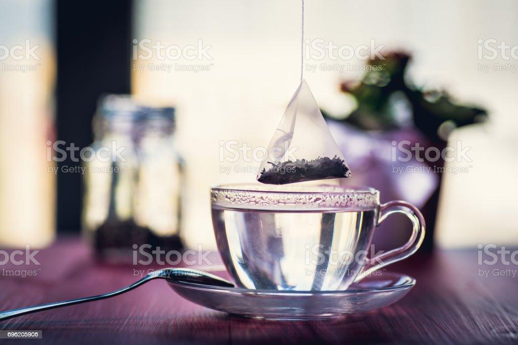 Someone preparing tea stock photo